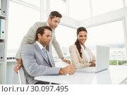 Купить «Business people using laptop in office», фото № 30097495, снято 8 мая 2014 г. (c) Wavebreak Media / Фотобанк Лори