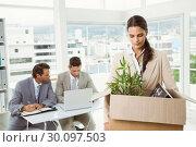 Купить «Businesswoman carrying her belongings in box», фото № 30097503, снято 8 мая 2014 г. (c) Wavebreak Media / Фотобанк Лори
