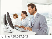Купить «Business people using computers in office», фото № 30097543, снято 8 мая 2014 г. (c) Wavebreak Media / Фотобанк Лори