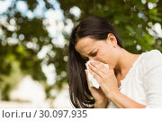 Купить «Sick brunette blowing her nose », фото № 30097935, снято 20 июня 2014 г. (c) Wavebreak Media / Фотобанк Лори