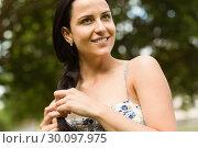 Купить «Portrait of a brunette in dress with braid», фото № 30097975, снято 20 июня 2014 г. (c) Wavebreak Media / Фотобанк Лори