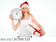 Купить «Festive blonde holding a clock and gift», фото № 30098535, снято 18 июля 2014 г. (c) Wavebreak Media / Фотобанк Лори