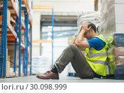 Купить «Tired man sitting on the couch with a headache», фото № 30098999, снято 26 июля 2014 г. (c) Wavebreak Media / Фотобанк Лори