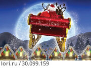 Composite image of santa flying his sleigh. Стоковое фото, агентство Wavebreak Media / Фотобанк Лори