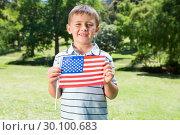 Купить «Little boy waving american flag», фото № 30100683, снято 17 ноября 2014 г. (c) Wavebreak Media / Фотобанк Лори