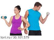 Купить «Fit man and woman lifting dumbbells», фото № 30101579, снято 13 ноября 2014 г. (c) Wavebreak Media / Фотобанк Лори