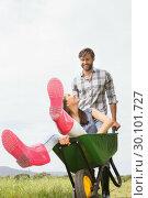 Купить «Man pushing his girlfriend in a wheelbarrow», фото № 30101727, снято 11 ноября 2014 г. (c) Wavebreak Media / Фотобанк Лори