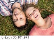 Купить «Cute couple in the park», фото № 30101971, снято 11 ноября 2014 г. (c) Wavebreak Media / Фотобанк Лори