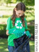 Купить «Happy little girl collecting rubbish », фото № 30102883, снято 17 ноября 2014 г. (c) Wavebreak Media / Фотобанк Лори