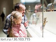 Купить «Father and daughter looking at religious art in museum», фото № 30103715, снято 22 апреля 2019 г. (c) Яков Филимонов / Фотобанк Лори