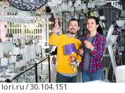 Купить «Man with girl points to interesting lamp», фото № 30104151, снято 16 февраля 2017 г. (c) Яков Филимонов / Фотобанк Лори
