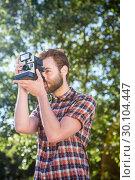 Купить «Handsome hipster using vintage camera», фото № 30104447, снято 19 ноября 2014 г. (c) Wavebreak Media / Фотобанк Лори