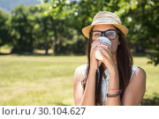 Купить «Pretty brunette having coffee to go», фото № 30104627, снято 19 ноября 2014 г. (c) Wavebreak Media / Фотобанк Лори