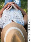 Купить «Woman napping in the park with book», фото № 30104651, снято 19 ноября 2014 г. (c) Wavebreak Media / Фотобанк Лори