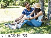 Купить «Hipster couple relaxing in the park», фото № 30104735, снято 19 ноября 2014 г. (c) Wavebreak Media / Фотобанк Лори