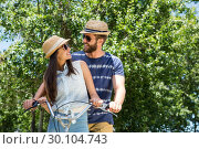 Купить «Hipster couple on a bike ride in the park», фото № 30104743, снято 19 ноября 2014 г. (c) Wavebreak Media / Фотобанк Лори