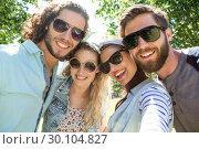 Купить «Happy friends taking a selfie», фото № 30104827, снято 19 ноября 2014 г. (c) Wavebreak Media / Фотобанк Лори