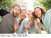 Купить «Happy friends taking a selfie», фото № 30104835, снято 19 ноября 2014 г. (c) Wavebreak Media / Фотобанк Лори