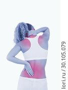 Купить «Blonde woman touching her neck and back as an indication of pain», фото № 30105079, снято 11 ноября 2011 г. (c) Wavebreak Media / Фотобанк Лори