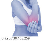 Young sporty woman touching her sore elbow. Стоковое фото, агентство Wavebreak Media / Фотобанк Лори