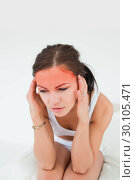 Купить «Cute brunette having a headache», фото № 30105471, снято 31 мая 2011 г. (c) Wavebreak Media / Фотобанк Лори