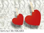 Купить «Composite image of hearts hanging on a line», фото № 30106683, снято 19 января 2015 г. (c) Wavebreak Media / Фотобанк Лори