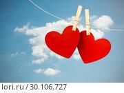 Купить «Composite image of hearts hanging on line», фото № 30106727, снято 19 января 2015 г. (c) Wavebreak Media / Фотобанк Лори