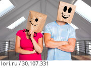 Composite image of young couple with bags over heads. Стоковое фото, агентство Wavebreak Media / Фотобанк Лори