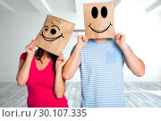 Купить «Composite image of young couple with bags over heads», фото № 30107335, снято 19 января 2015 г. (c) Wavebreak Media / Фотобанк Лори