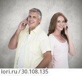 Купить «Composite image of casual couple on their phones», фото № 30108135, снято 21 января 2015 г. (c) Wavebreak Media / Фотобанк Лори