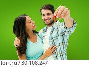 Купить «Composite image of happy young couple showing new house key», фото № 30108247, снято 21 января 2015 г. (c) Wavebreak Media / Фотобанк Лори
