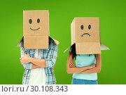 Купить «Composite image of young couple wearing sad face boxes over head», фото № 30108343, снято 21 января 2015 г. (c) Wavebreak Media / Фотобанк Лори