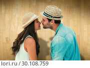 Купить «Composite image of happy hipster couple about to kiss», фото № 30108759, снято 21 января 2015 г. (c) Wavebreak Media / Фотобанк Лори