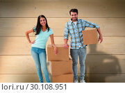 Composite image of attractive young couple with moving boxes. Стоковое фото, агентство Wavebreak Media / Фотобанк Лори