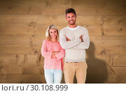 Composite image of attractive couple smiling with arms crossed. Стоковое фото, агентство Wavebreak Media / Фотобанк Лори