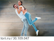 Composite image of attractive young couple hugging each other. Стоковое фото, агентство Wavebreak Media / Фотобанк Лори