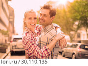 Купить «Couple in check shirts and denim hugging each other», фото № 30110135, снято 19 февраля 2014 г. (c) Wavebreak Media / Фотобанк Лори