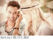 Купить «Cute couple listening to music together in cafe», фото № 30111363, снято 19 февраля 2014 г. (c) Wavebreak Media / Фотобанк Лори