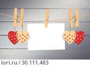 Купить «Composite image of hearts hanging on the line», фото № 30111483, снято 23 января 2015 г. (c) Wavebreak Media / Фотобанк Лори