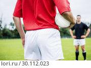 Купить «Rugby players playing a match», фото № 30112023, снято 9 сентября 2015 г. (c) Wavebreak Media / Фотобанк Лори