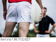 Купить «Rugby player standing with ball», фото № 30112027, снято 9 сентября 2015 г. (c) Wavebreak Media / Фотобанк Лори