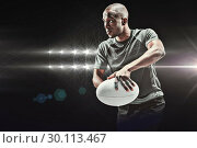 Купить «Composite image of determined rugby player in position to throw ball», фото № 30113467, снято 17 сентября 2015 г. (c) Wavebreak Media / Фотобанк Лори