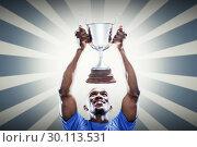 Купить «Composite image of happy sportsman looking up while holding trophy», фото № 30113531, снято 17 сентября 2015 г. (c) Wavebreak Media / Фотобанк Лори