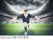 Купить «Composite image of rugby player tackling the opponent», фото № 30113915, снято 17 сентября 2015 г. (c) Wavebreak Media / Фотобанк Лори