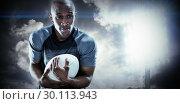 Купить «Composite image of rugby player smiling while catching ball», фото № 30113943, снято 17 сентября 2015 г. (c) Wavebreak Media / Фотобанк Лори