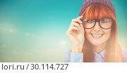 Купить «Composite image of smiling hipster woman looking at camera», фото № 30114727, снято 5 февраля 2016 г. (c) Wavebreak Media / Фотобанк Лори