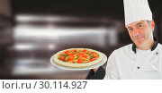 Купить «Composite image of friendly chef holding a pizza», фото № 30114927, снято 27 апреля 2016 г. (c) Wavebreak Media / Фотобанк Лори