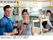 Happy young couple with wineglass . Стоковое фото, агентство Wavebreak Media / Фотобанк Лори