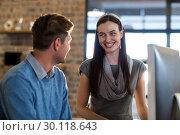 Купить «Colleagues by computer in office», фото № 30118643, снято 27 апреля 2016 г. (c) Wavebreak Media / Фотобанк Лори