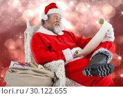 Купить «Santa reading letter against blurry red background», фото № 30122655, снято 23 ноября 2016 г. (c) Wavebreak Media / Фотобанк Лори